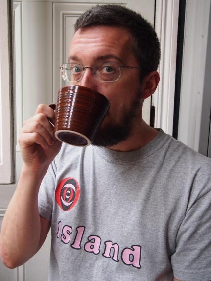 Picture of Tom Bolton drinking a cup of coffee